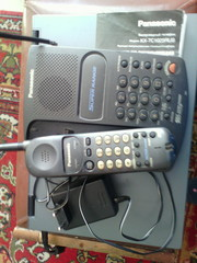Беспроводный телефон Panasonic KX-TC1025RUB с базой и функцией импульс